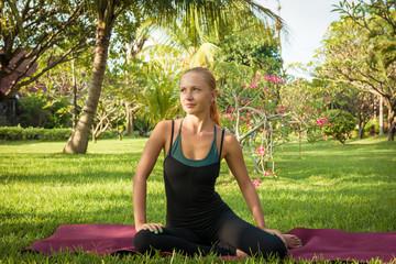 Woman doing yoga in garden