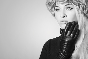 Monochrome portrait of Beautiful Blond Girl in Leather Gloves