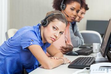 Tired Customer Service Representatives At Desk