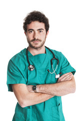 Young serious doctor with green uniform.Isolated on white.