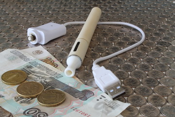 Electronic Cigarette on a background of money