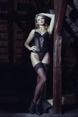 Sensual woman in underwear posing on timber