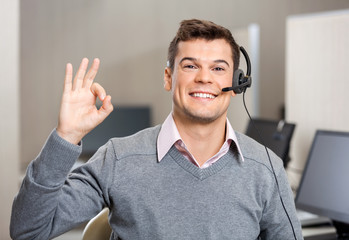 Customer Service Representative Showing Ok Sign