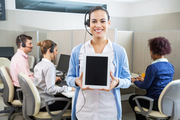 Happy Customer Service Representative Showing Tablet Computer