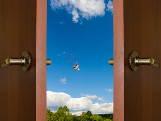 colorful kite open door