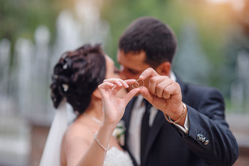 Groom and bride together with rings. Wedding couple