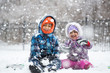 Little Children Enjoying Snowfall and Playing in the Snow - 78701970