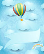 Hot air balloon and banner on sky background