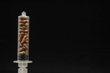 medical syringe on a drugs...