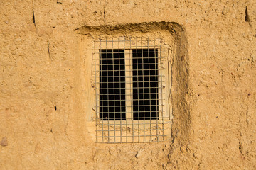 Window in Adobe Wall
