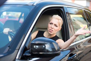 Unhappy young woman in traffic jam