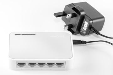 Five port ethernet switch with adaptor