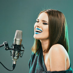 Expression woman singer portrait with microphone. Beautiful mod