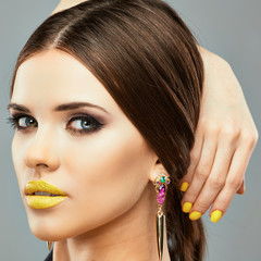 Model Beauty Yellow Lips. Isolated close up face