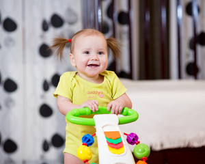 Cute baby standing with support