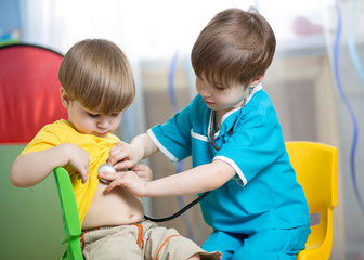 children boys play doctor at home