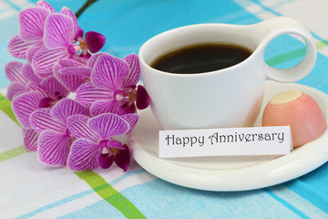 Happy Anniversary card with pink orchid and cup of coffee
