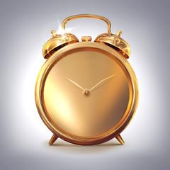 Golden old fashioned  alarm clock on grey  background.