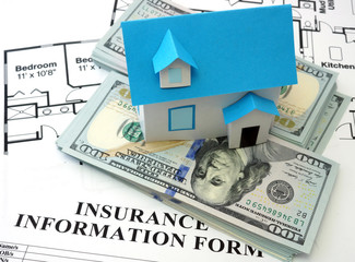model house and insurance form with  dollars