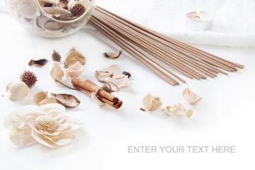 Cinnamon, perfume sticks,  aroma candle and ornamental dried flo