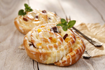Sweet bun with raisins and cheese