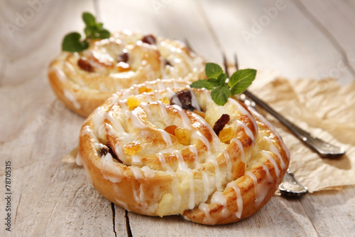 Sweet bun with raisins and cheese - 78705315