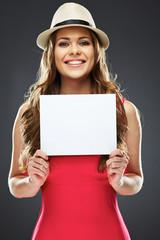joyful woman holding white advertising board.