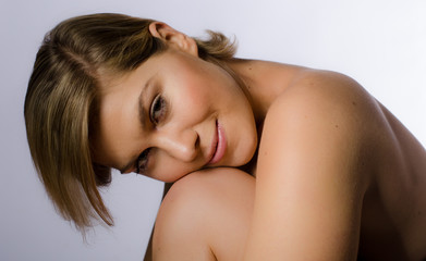 Beautiful woman resting her chin on knee