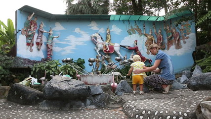 mother shows small blonde child religious composition in buddha