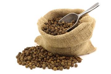 dried allspice(Jamaica pepper) in a burlap bag