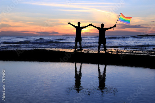 canvas print picture Gay men holding a pride flag.