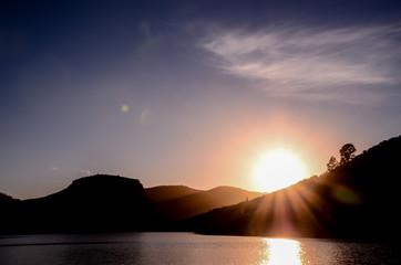 Sun over a Mountain Silhouette