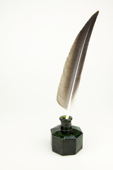 Quill pen and vintage glass inkwell isolated