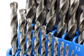 set of hardened steel metal drill bits in a blue plastic box on