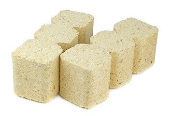 Compressed sawdust briquettes heating fuel on a white background