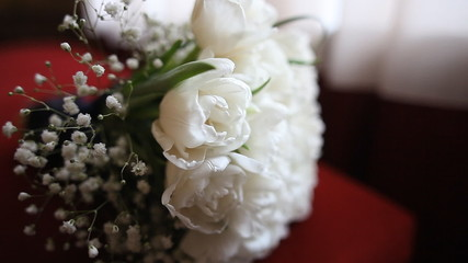 Nice wedding bouquet of white tulips on red branch