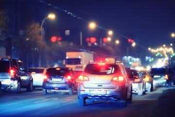 Night road in the city of lights cars traffic jams