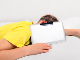 Tired Kid with Tablet Computer