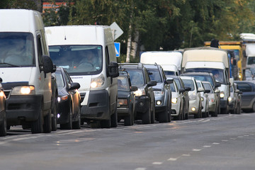 traffic on the road in a European city, stopping vehicular traff