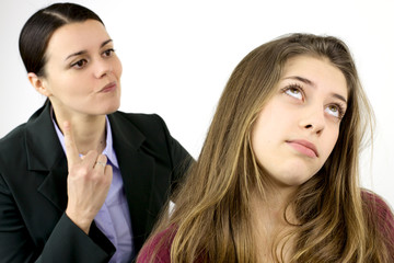 Young female teenager annoyed by angry mother