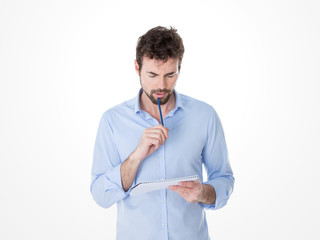 young man reviewing his notes