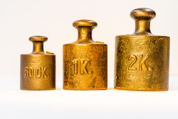 Collection of Vintage Golden Calibration Weights