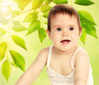Cute baby girl on natural background