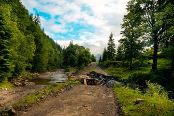 Broken bridge on the mountain river in the Carpathians, Ukraine