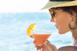 Girl Drinking Cocktail At Sea