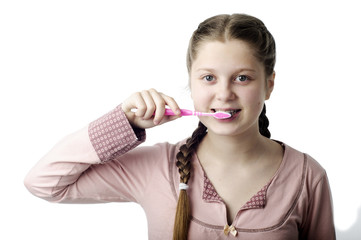 Cute girl brushing teeth on white