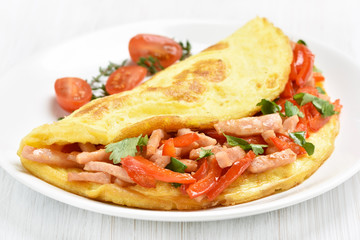 Omelette with ham and vegetables