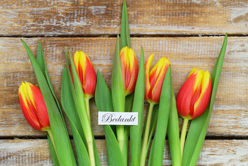 Bedankt (Thank you in Dutch) with red and yellow tulips