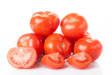 Fresh tomatoes isolated on white. Closeup of tomatoes