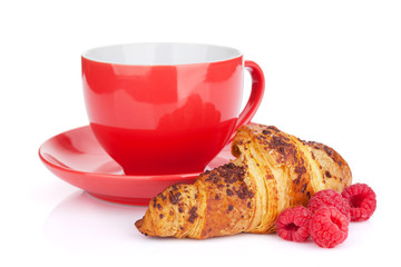 Cup of coffee, fresh croissant and berries